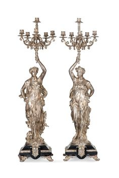 Pair of candelabra from Napoleon III period signed L. Grégoire in silvered bronze representing draped women, 6 arms of light, h. 100 cm.