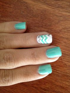 Mint chevron nails... Like the ring finger nail