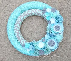 Double Wrapped Fabric Wreath with felt flowers. Made by Wreaths By Emma Ruth.