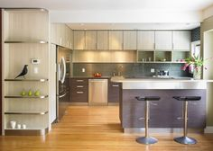 This kitchen remodel designed by Ines Hanl would be a stylish backdrop for a Mercury range cooker. A Stainless Steel cooker would compliment the Stainless Steel accents or a Purple Haze model could inject the kitchen with an artistic edge.