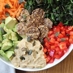 Simple Rainbow Salad with a Hummus Dressing   This is my go-to lunch when I'm working at home.  It's so quick, so easy and so delicious. It's so energizing too so you'll feel amazing all day.  The crispy kale and pumpkin seeds add a delicious crunch, which perfectly contrasts the creamy avocado and hummus. The red pepper and grated carrot then adds a wonderful sweet touch. Finally the dressing brings everything together with its incredible blend of hummus, olive oil, almond butter, maple…
