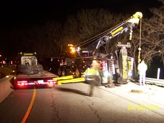 peterbilt holmes 750 and a drag winch tow trucks waffco working a rollover on the na toll road loaded van trailer spooled wire