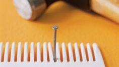 Use a comb to hold a nail in place to save your fingers from injury.