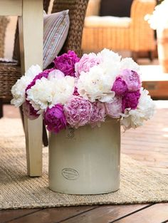 .oooh just bought these old ceramic pots at an antique store, would be pretty like this...with peonies.