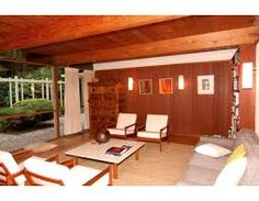 Original Mid-Century furniture and finishes in this 1950s house.