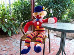 Hand knitted clown relaxing.