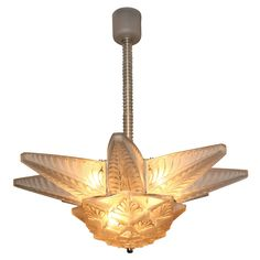 """R. LALIQUE """"Stockholm II"""" Art Deco Chandelier   From a unique collection of antique and modern chandeliers and pendants  at http://www.1stdibs.com/furniture/lighting/chandeliers-pendant-lights/"""