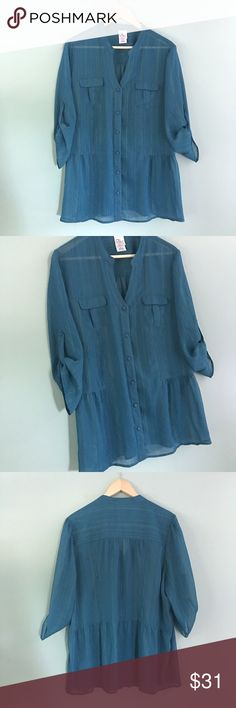 "PlusSz-Teal Sheer Blouse Teal sheer 3/4 length sleeve button-down blouse with metallic gold threading // sz 2X // Just My Size brand (plus size) // style JM9425. Color: Venice Blue // 100% polyester // 26"" across armpits laid flat // 28"" length // two front pockets // not my size. Can't model. // non-smoking home // 20% off 3+ Bundles // offers welcome! // Same Day or Next Day Shipping!! 6.19.31eb No trades Just My Size Tops Button Down Shirts"