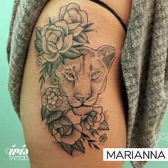 Lioness flowers roses tattoo