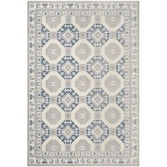 Anchor an elegant dining room ensemble or define space in the den with this dignified rug, featuring an ornate pattern in blue and ivory.