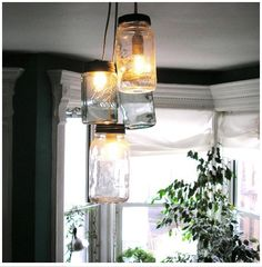 """I saw this and said, """"Oh, of course!""""  Mason jar light fixtures."""