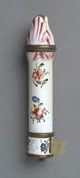 Bodkin (Needle) Case with Tape Measure. c. 1770. Made in England, Europe. Enamel on copper with hand-painted decoration and traces of gilt decoration; metal mounts; silk tape  Height (excluding crank): 3 11/16 inches (9.4 cm). 1975-140-75a,b  The Richard P. Rosenau Collection, 1975. Philadelphia Museum of Art.