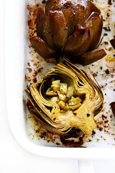 Seriously the most amazing roasted artichokes recipe! They're stuffed with lots of garlic and herbs, seasoned with lots of lemon and black pepper, and roasted to crispy, tender perfection. The perfect vegetable side dish! Roasted Artichoke Recipe, Roasted Artichokes, Roasted Garlic, Baked Artichoke, Vegan Artichoke Recipes, Vegetable Recipes, Vegetarian Recipes, Cooking Recipes, Healthy Recipes
