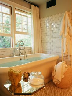 I like the free standing tub by the windows. Would definitely need some shelving near by to hold my books and magazines.