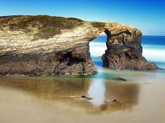 """Beach of the Cathedrals, Ribadeo, Lugo, Spain - strking rock formations with """"naves"""" formed into 30m cliffs. Picture: Pablo Charlon/Getty Images"""