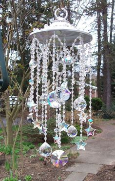 Lovely 47 Beautiful Beaded Wind Chime to Add Sparkle to The Garden http://godiygo.com/2017/11/24/47-beautiful-beaded-wind-chime-add-sparkle-garden/