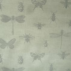 Bugs design oilcloth in grey on a cream background Matt finish on a woven cotton backing