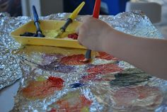 Painting on Aluminum Foil. Use dish soap to help it stick.