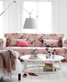 I'm not usually super girly, but I LOVE this pink floral print paired with the all white around it. living room