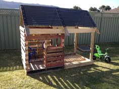 My husband built this amazing cubby and sandpit from pallets, plus a quick trip to Bunnings for some roofing material. Our son loves it!