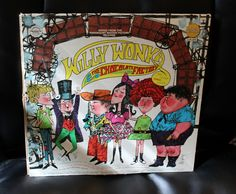 A really groovy loooking Willy Wonka Record. I never had this as a kid but I loved the movie. Even though the dark parts kind of confused and scared me. The family never gets out of bed except for Charlie, All the bad kids are punished and its never really explained what happens to them and Charlie nearly dies from a giant fan. Yep Kiddie entertainment.