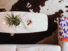 We have a coffee table now ✌🏽 #happynewyear #endonagoodnote #marble #fauxcowhide #plant #matisse #chloesevigny #design #interiordesign #home #apartment #coffeetable #marblecoffeetable #midcentury #modern #cozy #fremont #seattle #westcoast