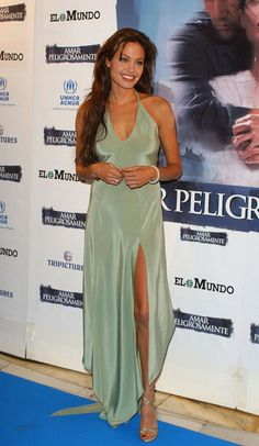 "For the ""Beyond Borders"" world premiere, Angie wore a simple yet stunning green gown and matching strappy sandals. 2003"