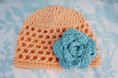 """Free Pattern: Open Stitch Hat - 3 Months      Newborn size here.    On the three-month size I used the open version of the large no-sew rose.  Love these colors.  Supplies:  Worsted Weight Yarn (I used """"I Love This Cotton"""" by Hobby Lobby for the hat and Red Heart Soft for the rose.)  Size 5mm (H/8) hook  Opt tapestry needle    Abbreviations:  Ch - chain  Dc - double crochet  Sl st - slip stitch  Sc - single crochet    Instructions:  Round 1: Magic Ring, ch 3.  10 dc inside ring.  Pull ring…"""