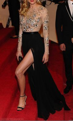 Heavy embellishment and thigh high split on the red carpet . Any one know who this beautiful woman is ? Glamour in Streetstyle