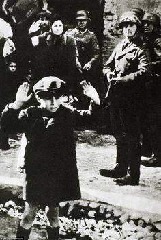 Nazi hell: The terrified young boy with his hands raised was one of almost half a million Jews packed into the Warsaw ghetto, a neighborhood transformed by the ­Nazis into a walled compound of starvation and death. The photo was taken in 1943