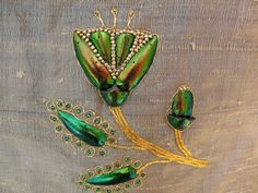 Beetle Wing Embroidery: second round, flower, from WormSpit - A blog about silkworms, silkmoths, and silk