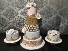Tiered baby pink and gold wedding cake