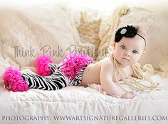 Hey, I found this really awesome Etsy listing at http://www.etsy.com/listing/103188292/zebra-striped-with-hot-pink-ruffles-baby