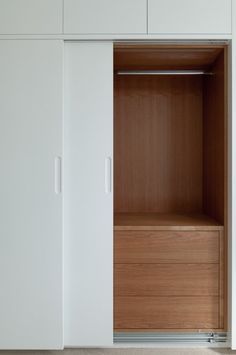 Sliding sprayed doors reveal lit cherry interiors with push to open drawers.