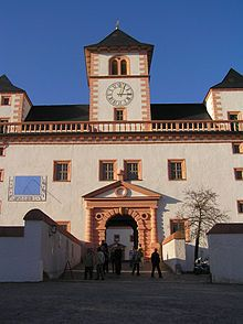 The hunting lodge of Augustusburg (German: Jagdschloss Augustusburg) was built from 1568 to 1572 above the town of the same name on a hill called the Schellenberg (516 m above sea level) on the northern edge of the Ore Mountains of Germany. The castle, which is visible from afar, is a local landmark. It lies about 12 kilometres east of the city of Chemnitz and about 21 kilometres southwest of Freiberg in the Free State of Saxony.