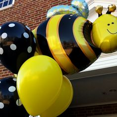 """Balloon bouquet welcoming guests to """"What will it 'bee?'"""" baby shower"""