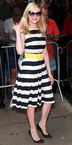 I like Kirsten Dunst's striped dress + yellow belt combo here.