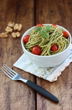 Freshly shredded zucchini noodles with tasty pesto sauce, along with popping red cherry tomates and crunchy walnuts..this will take you to Italy!