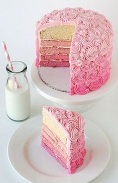 Pink ombre cake. LOVE it! How cool for a baby shower for a girl? You could also do it for a wedding shower, or even a wedding cake, using the main color of the wedding for the shades. Now if I could just have the coordination to make the icing swirls....