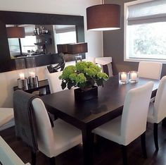 I don't care for the white cloth chairs (too 'dirty' in a dining room) but I love the boldness of this room