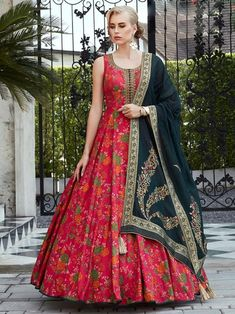 Outstanding maroon digital printed gown online at best shopping price. Shop this latest gown style for diwali celebration. This alluring style set comprises a silk gown with matching jacquard dupatta.