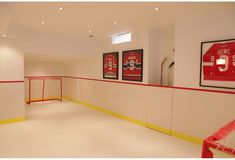 This indoor hockey rink with synthetic ice is the ultimate in cool for a hockey-inspired kid's playroom.