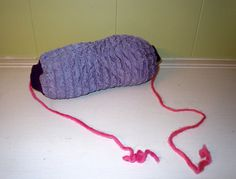 Skeini-T:  A beautiful way to protect, carry, and store yarn!  Will also allow for working with 2 skeins of yarn.