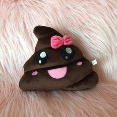 KAWAII POOP EMOJI PILLOW⭐️ Kawaii poop emoji!  Super cute fave with a pink bow !  Shes super unique ! Rare to find ! no trades  Price is firm Accessories