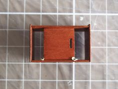This is a tutorial for a small mid century record player and cabinet to  hold records. This tutorial is of moderate difficulty, and requires the use  of wood stain.