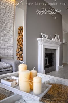 simply about home: white / grey / black / livingroom / fireplace / brick walls / wood