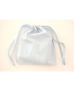 Sacca in piquè di cotone per il fasciatoio e gli accessori per l'igiene del bambino.