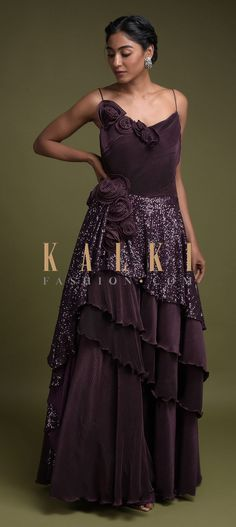 Buy Online from the link below. We ship worldwide (Free Shipping over US$100)  Click Anywhere to Tag Grape Purple Gown In Crushed Lycra And Sequins With Layered Silhouette And 3D Flowers Online - Kalki Fashion Grape purple gown in crushed lycra with layered silhouette.Enhanced with sequins embellished draped layer on the waist.