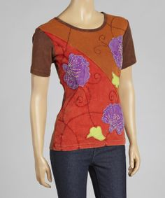 Earthy and out of the ordinary, this breezy top adds free-spirited flair to any ensemble. Boasting a comfy cotton construction and charming embroidered details, this pretty piece feels as fabulous as it looks.  Note: This one-of-a-kind item is handmade and may appear in colors other than shown.