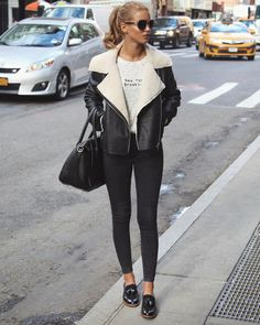 Shearling jacket, skinny jeans, loafers, black tote.